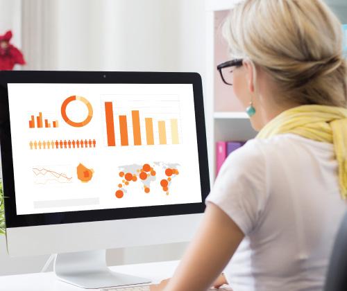 Woman looking at visual data onscreen